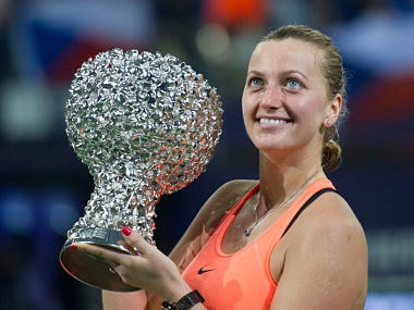 Petra Kvitova of the Czech Republic poses with her winners trophy after defeating Elina Svitolina of Ukraine in the WTA Elite Trophy tournament. AP