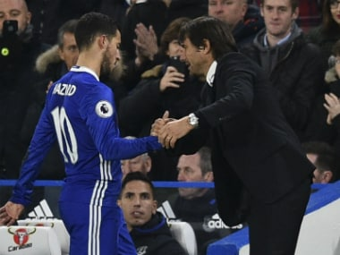 Conte (R) was pleased with Chelsea's performance but reckons improvement is possible. AFP