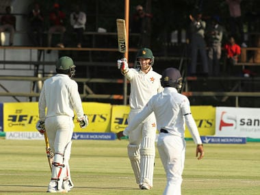 Craig Ervine celebrates after reaching his fifty on day two against Sri Lanka. AP