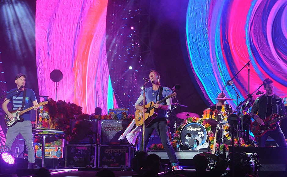 Chris Martin, lead singer of Coldplay, performs with band members Will Champion and Guy Berryman among others. Sachin Gokhale/Firstpost