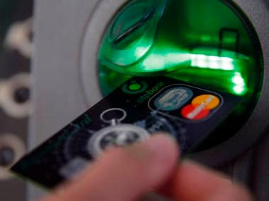A customer performs a transaction on an ATM at a branch of Hungary's largest lender OTP Bank in central Budapest July 24, 2013. REUTERS/Laszlo Balogh (HUNGARY - Tags: BUSINESS) - RTX11X2Y