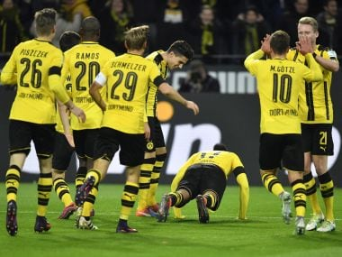 Dortmund players celebrate their goal. AP