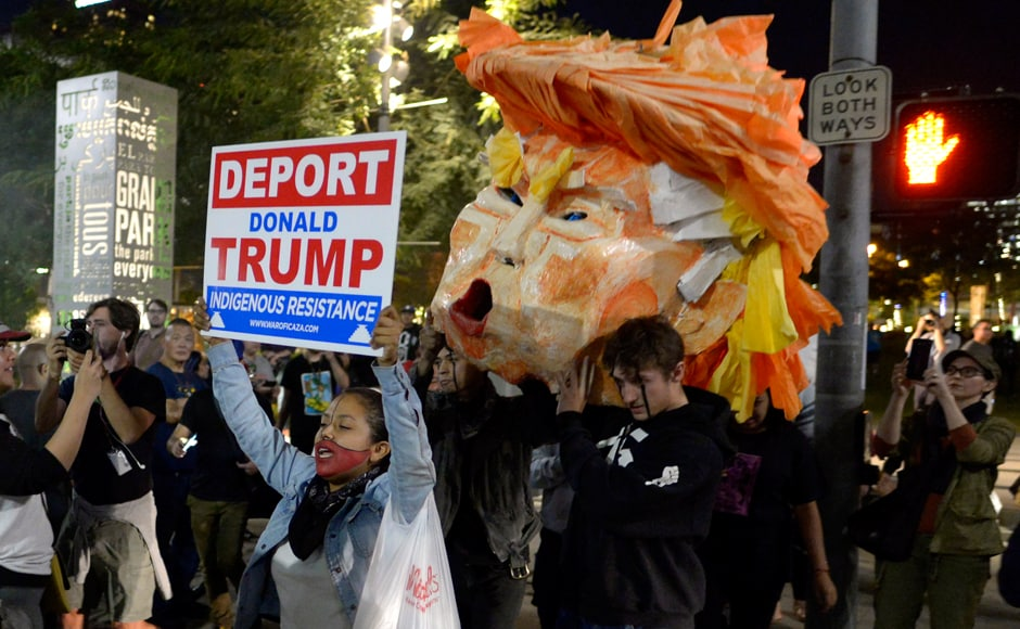"And held signs that read ""Trump Makes America Hate"" and chanted ""hey, hey, ho, ho Donald Trump has got to go."" and ""Impeach Trump."" Reuters"