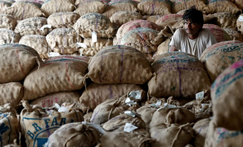 A labourer sits amongst sacks of unsold potatoes at a wholesale market in Manchar village in Maharashtra. Reuters