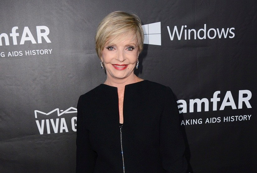 """In this October, 2014 file photo, Florence Henderson arrives at the 2014 amfAR Inspiration Gala at Milk Studios in Los Angeles. Henderson, the wholesome actress who went from Broadway star to television icon when she became Carol Brady, the ever-cheerful mom residing over """"The Brady Bunch,"""" has died at age 82. She died surrounded by family and friends, her manager, Kayla Pressman, said in a statement late Thursday, Nov. 24, 2016. (Photo by Jordan Strauss/Invision/AP, File)"""