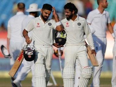 Virat Kohli and Ravindra Jadeja walk back after drawing the Rajkot Test. AP