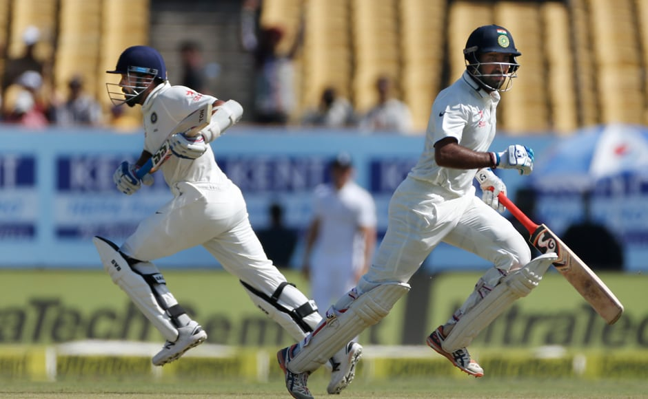 Cheteshwar Pujara runs between the wicket with Murali Vijay, on the third day of the first Test match between India and England in Rajkot. AP