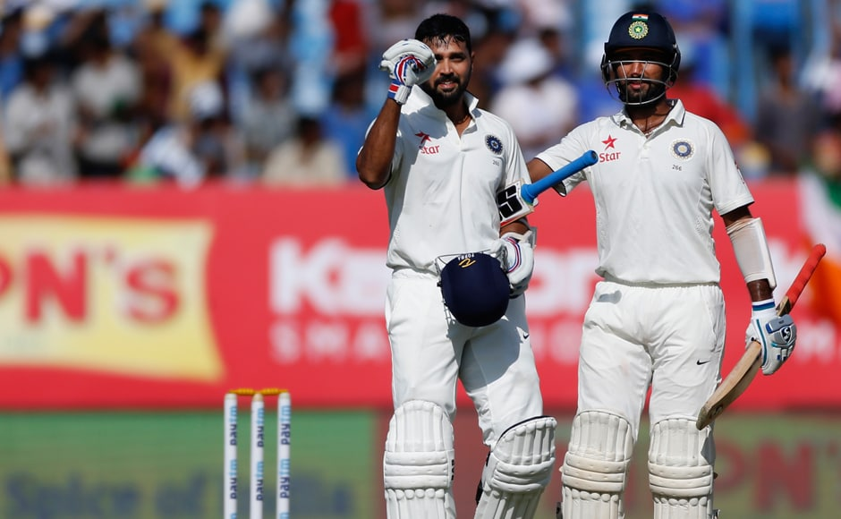 Centuries by Murali Vijay and Cheteshwar Pujara pushed India to 319-4 and behind England by 218 runs on day three of the first Test in Rajkot on Friday. AP