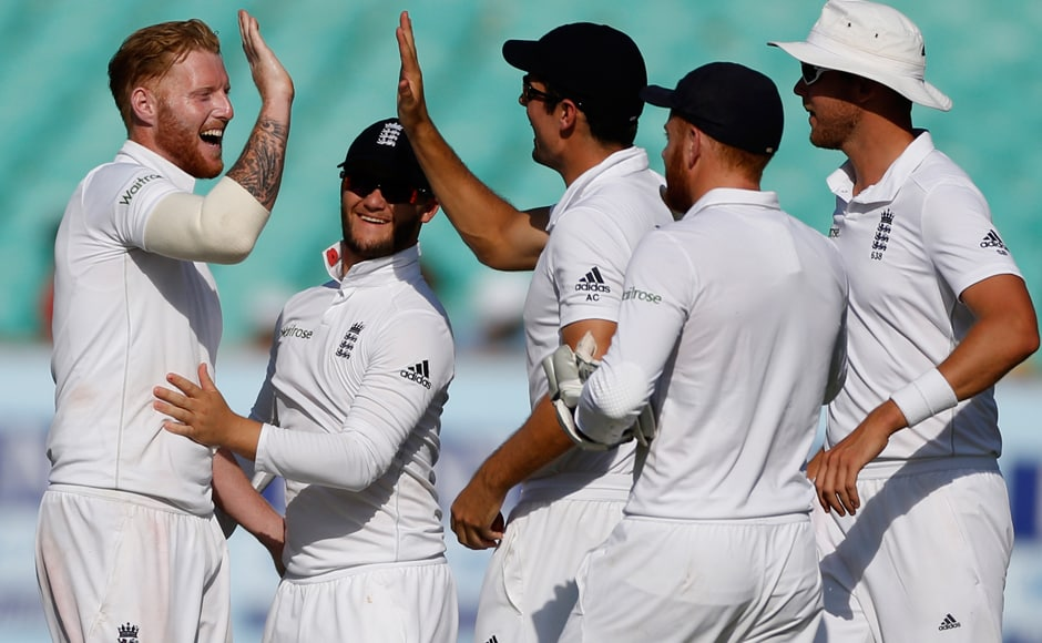 England's players celebrate after taking the wicket of Cheteshwar Pujara. AP