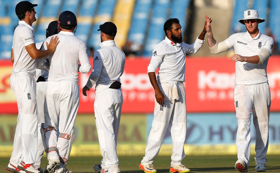 England players celebrate the wicket of Murali Vijay. AP