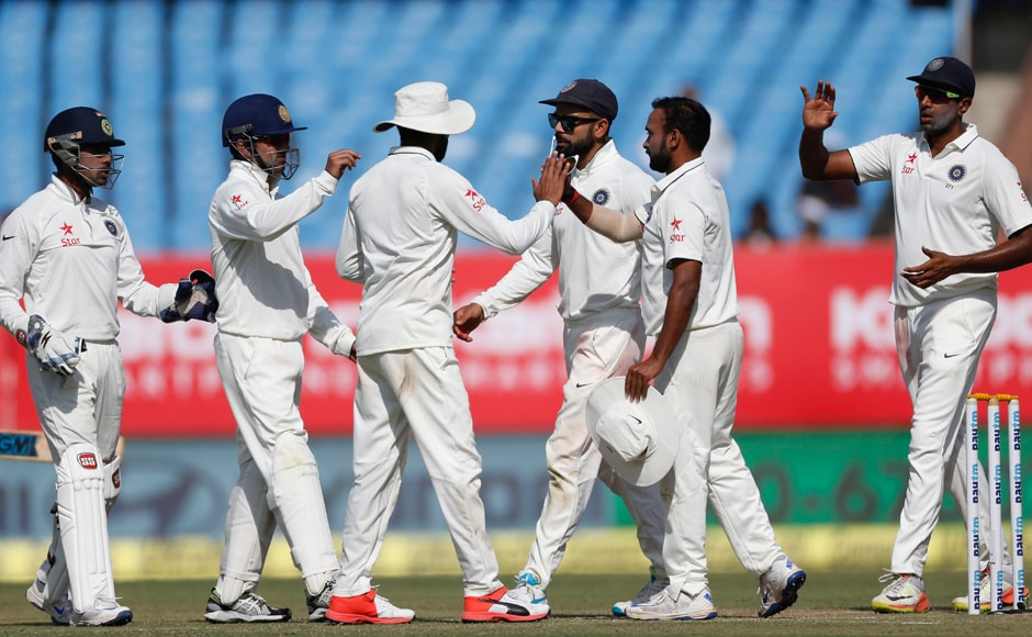 India players celebrate the wicket of England's Zafar Ansari on Day 2 of the 1st Test at Rajkot. AP