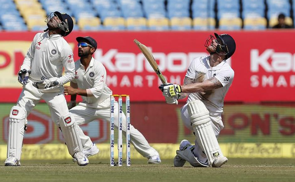 Indian wicketkeeper Wriddhiman Saha and Ajinkya Rahane watch the ball off the bat of England's Ben Stokes. Reuters