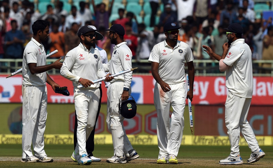 Indian captain Virat Kohli (2L) celebrates with teammates after victory over England in the second Test against England at Visakhapatnam. AFP