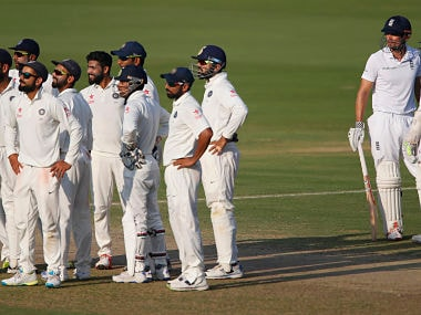 Indian players wait for a television umpire decision on England's batsman Haseeb Hameed after asking for a review on the fourth day. AP