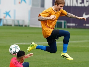 Justin Bieber and Neymar play football during his visit to Barcelona's training ground. Image credit: Twitter/@neymarjr