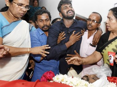 Family of a deceased BJP activist at funeral. Image sourced by TK Devasia.