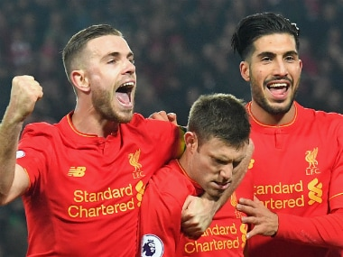 The Liverpool players celebrates a goal against Sunderland. AP