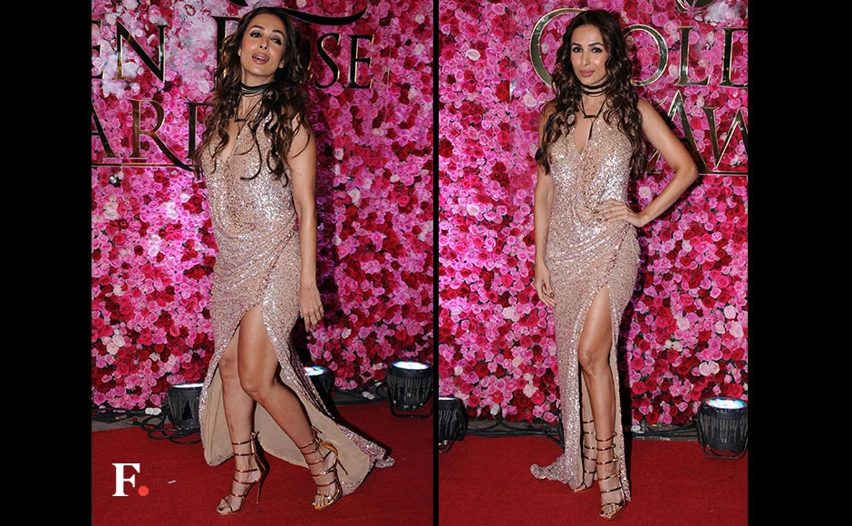 Malaika Arora Khan slayed the red carpet, teaming her look with soft curls and a nude lip colour. FirstPost/ Sachin Gokhale