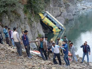 Rescue operation in progress after a bus fell into Beas river on Delhi-Manali national highway near Mandi on Saturday. PTI