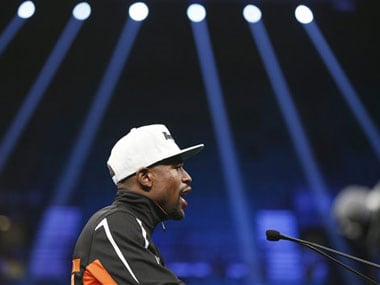 Floyd Mayweather retired with a 49-0 record. AP