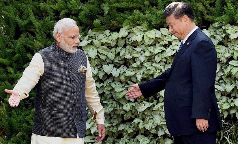 Prime Minister Narendra Modi with Chinese President Xi Jinping. PTI