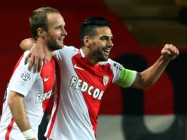 Monaco's Radamel Falcao (R) celebrats with goalscorer Valere Germain, Reuters