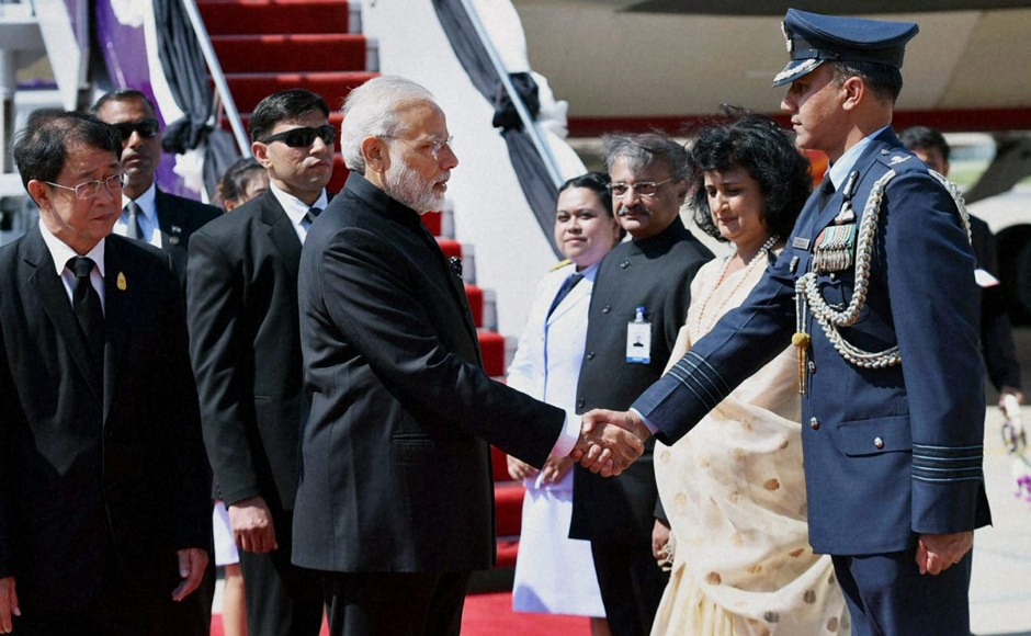 Prime Minister Narendra Modi, on his way to Japan, arrived in the Thai capital on Thursday for a brief stopover to pay homage to the late King Bhumibol Adulyadej, the world's longest-ruling monarch, who died last month. (Photos: PTI)