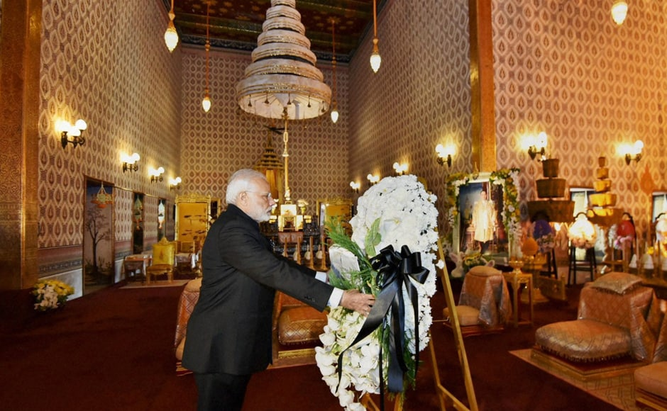 PM Modi laid a wreath and paid his respects to the mortal remains of the late king, whose body has been kept at the Grand Palace complex in Bangkok. (Photo: PTI)