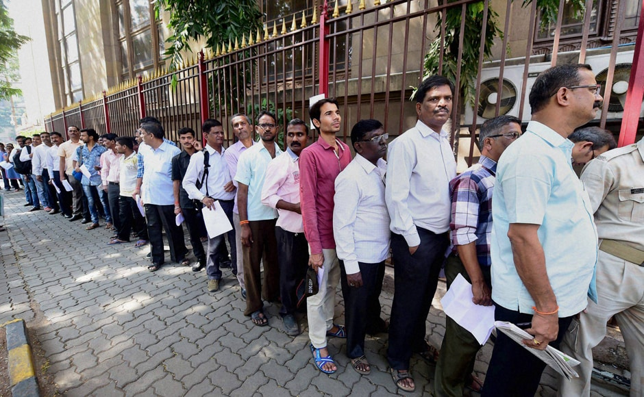 People rushed to Reserve Bank of India branch in Mumbai on Thursday as many ATMs ran out of cash in couple of hours due to heavy rush. PTI