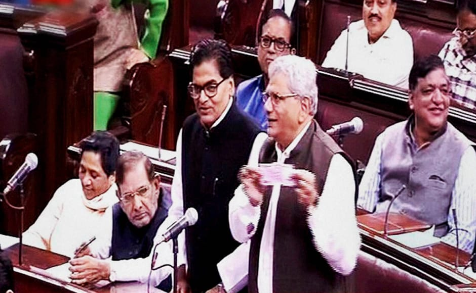 Samajwadi Party member Ramgopal Yadav speaks as CPI(M) leader Sitaram Yechury shows a Rs 2000 note in the Rajya Sabha on the opening of the winter session of Parliament in New Delhi on Wednesday. Yadav also narrated the woes of the common man, claiming that the man on the street didn't even has cash to buy vegetables. PTI