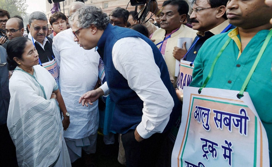 "Mamata talks to TMC leader Derek O'Brien during the march. Mamata also said ""Those with black money have been supported, but taxpayers are suffering"", and added that the situation arising out of demonetisation has triggered a sort of constitutional crisis and financial emergency. PTI"