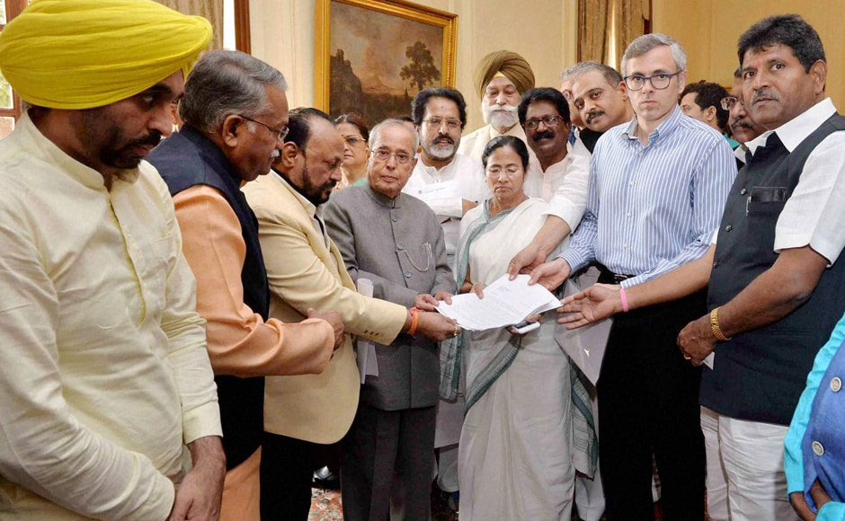 President Pranab Mukherjee receives a memorandum from West Bengal Chief Minister Mamata Bannerjee, AAP leader Bhagwant Mann, National Conference leader Omar Abdullah and a delegation of MPs over demonetisation issue, at Rashtrapati Bhavan in New Delhi. PTI