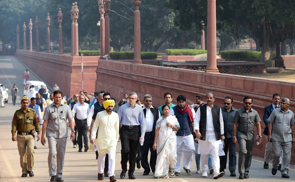 TMC Supremo and West Bengal Chief Minister Mamata Bannerjee, National Conference leader Omar Abdullah, AAP MP Bhagwant Mann and MPs at the protest march towards Rashtrapati Bhavan. PTI