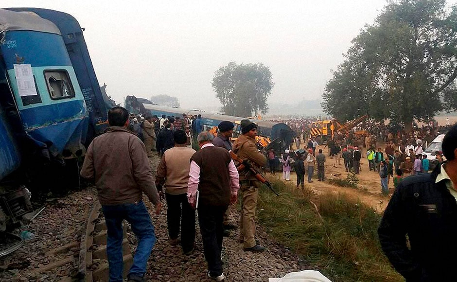 Police officers on the spot where 14 coaches of the Indore-Patna express derailed, killing around 90 people and injuring 150, in Kanpur Dehat on Sunday. PTI