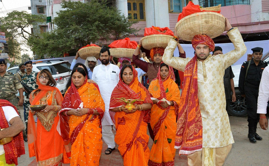 Lok Janshakti Party leader and MP Chirag Paswan carrying a basket with fruits for Chhath Puja in Patna with Union Minister Ramvilas Paswan and family members. PTI
