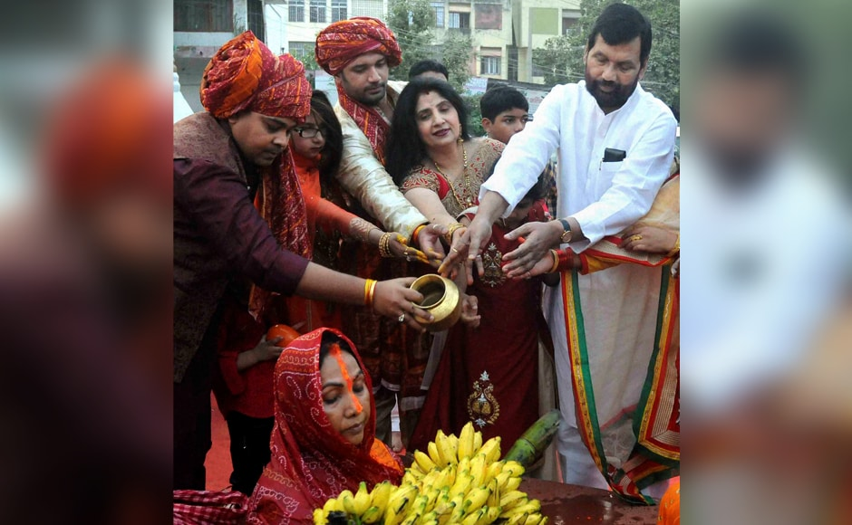 Union Minister Ram Vilas Paswan, his wife and son and MP Chirag Paswan performing rituals on the occasion of the Chhath festival in Patna on Sunday. PTI