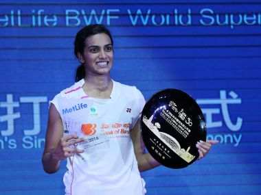 PV Sindhu celebrates with her trophy after winning the China Open. AFP