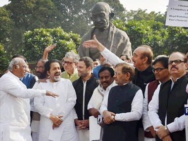 Opposition members form a human chain during a protest against the demonetization of Rs 500 and Rs 1000 notes at Parliament house in New Delhi on Wednesday. PTI
