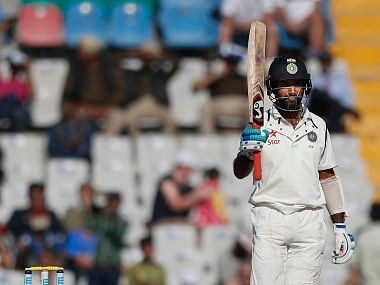 Pujara acknowledges the crowd his half-century on the Day 2 of 3rd Test against England in Mohali. AP