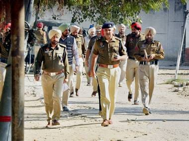 Police officials investigate after six inmates of Nabha Jail including dreaded Khalistan ultra and Khalistan Liberation Force (KLF) chief Harminder Mintoo escaped near Patiala on Sunday. PTI