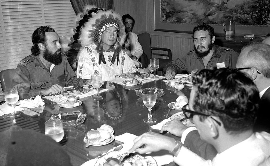 Fidel Castro (R) meets with Reverend WA Raifford (2nd-L), chief of the White Birds from the Creek Indians in Havana, 16 July, 1959. Raifford gave Castro the name Spiheechie Meeko (Big Warrior Chief). The bearded, cigar-puffing leader, renowned for trademark army fatigues and hours-long public tirades, grabbed power in a January 1, 1959 revolution. Living by the slogan