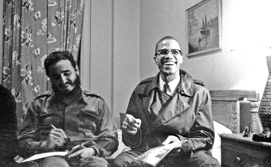 Fidel Castro shares a laugh with Malcolm X at the Hotel Theresa in New York, 19 October, 1960. In April 1961, he weathered an invasion attempt by some 1,300 CIA-trained Cuban exiles at the Bay of Pigs. Reuters