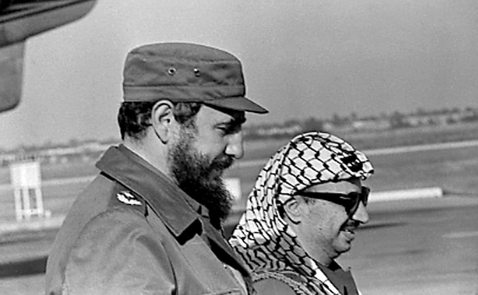 Fidel Castro (L) and PLO leader Yasser Arafat stand together at the airport in Havana during Arafat's first visit to Cuba on 14 November, 1974. Castro strode the world stage as a communist icon when the Cold War was at its height. He sent 15,000 soldiers to help Soviet-backed troops in Angola in 1975 and dispatched forces to Ethiopia in 1977. Reuters
