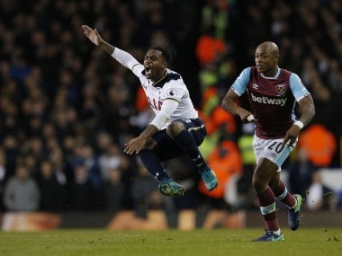 Tottenham's Danny Rose in action with West Ham United's Andre Ayew. Reuters