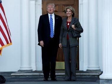 US President-elect Donald Trump with Betsy DeVos. Reuters