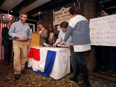 One of the first US voters to cast a ballot in the US presidential election at midnight in tiny Dixville Notch. Reuters