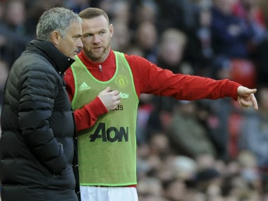 File photo of Manchester United captain Wayne Rooney (R) and manager Jose Mourinho. AP