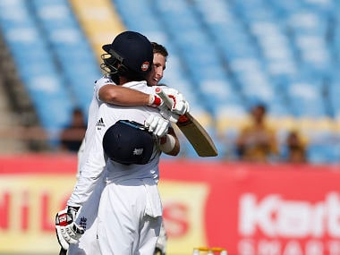 Joe Root celebrates with Moeen Ali after reaching his century. AP