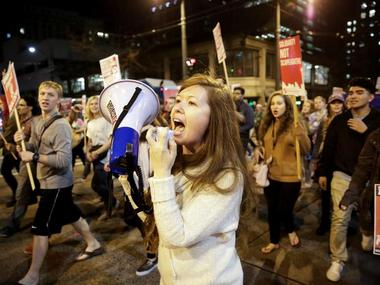 People march in protest to the election of Republican Donald Trump as the president of the United States in SeattlE. Reuters