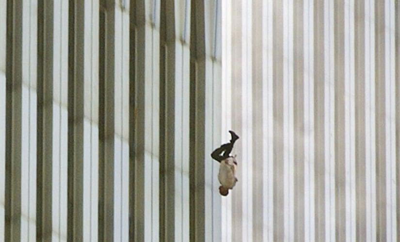 FILE - In this Tuesday, Sept. 11, 2001 file picture, a person falls headfirst from the north tower of New York's World Trade Center. This iconic image is included in Time magazine's most influential images of all time, released Thursday, Nov. 17, 2016, through a new book, videos and a website, Time.com/100photos. (AP Photo/Richard Drew, File)